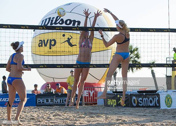 Kerri WalshJennings spikes the ball against Carol Welcher as April Ross looks on at the AVP New Orleans Open at Laketown on May 23 2015 in Kenner...