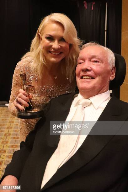 KerriAnne Kennerley and her husband John Kennerley pose with the Hall Of Fame Logie Award during the 59th Annual Logie Awards at Crown Palladium on...