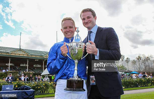 Kerrin McEvoy and assistant trainer James Ferguson pose with the trophy after winning Jayco Bendigo Cup at Bendigo Racecourse on October 26 2016 in...