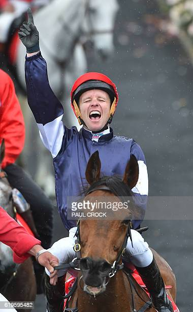 Kerrin McEvoy reacts after winning the Melbourne Cup on Almandin at Flemington Racecourse in Melbourne on November 1 2016 / AFP / Paul CROCK / IMAGE...