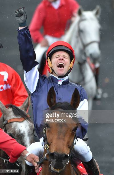 Kerrin McEvoy reacts after winning the Melbourne Cup on Almandin at Flemington Racecourse in Melbourne on November 1 2016 / AFP PHOTO / Paul CROCK /...