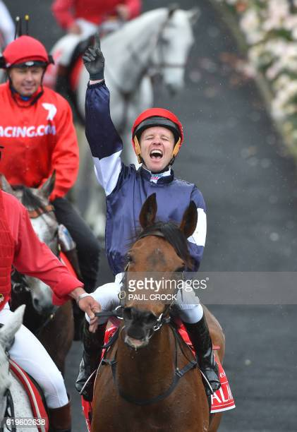 Kerrin McEvoy reacts after winning the Melbourne Cup on Almandin at Flemington Racecourse on Melbourne Cup day in Melbourne on November 1 2016 / AFP...