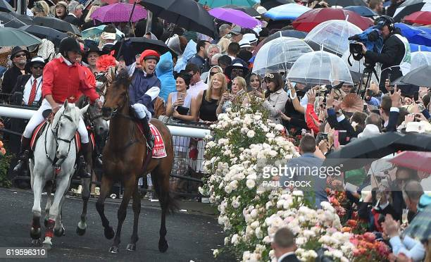 Kerrin McEvoy reacts to the crowd after winning the Melbourne Cup on Almandin at Flemington Racecourse on Melbourne Cup day in Melbourne on November...