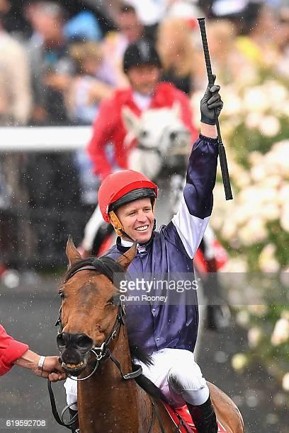 Kerrin McEvoy riding Almandin celebrates winning race 7 the Emirates melbourne Cup on Melbourne Cup Day at Flemington Racecourse on November 1 2016...