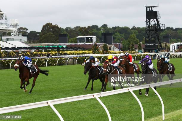 Kerrin McEvoy riding Ashrun wins race four the Lexus Hotham Stakes from Jamie Kah riding Sound and Hugh Bowman riding Brimham Rocks during 2020 AAMI...