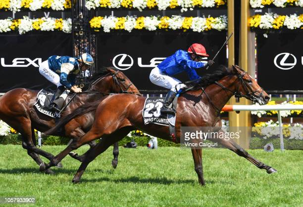 Kerrin McEvoy riding Cross Counter defeats Hugh Bowman riding Marmelo in Race 7 Lexus Melbourne Cup during Melbourne Cup Day at Flemington Racecourse...