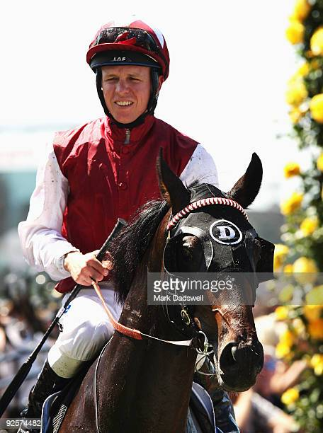 Kerrin McEvoy riding Kidnapped returns to scale after winning the Inglis Carbine Club Stakes during the 2009 Victoria Derby Day meeting at Flemington...