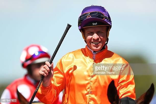 Kerrin McEvoy riding 'Takedown' celebrates winning Race 1, The Schweppervesence during Sydney Racing at Rosehill Gardens on March 28, 2015 in Sydney,...
