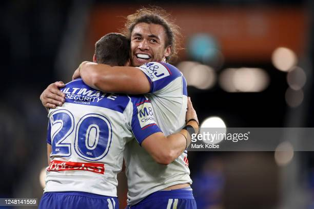 Kerrod Holland and Raymond Faitala-Mariner of the Bulldogs celebrate winning the round four NRL match between the Canterbury Bulldogs and the St...