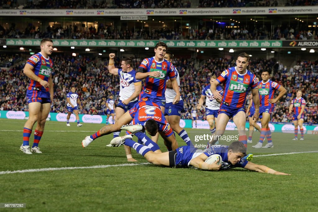 Kerrod Holland of the Bulldogs scores a try during the round 16 NRL match between the Newcastle Knights and the Canterbury Bulldogs at McDonald Jones Stadium on June 30, 2018 in Newcastle, Australia.