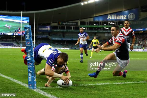 Kerrod Holland of the Bulldogs scores a try during the round two NRL match between the Sydney Roosters and the Canterbury Bulldogs at Allianz Stadium...