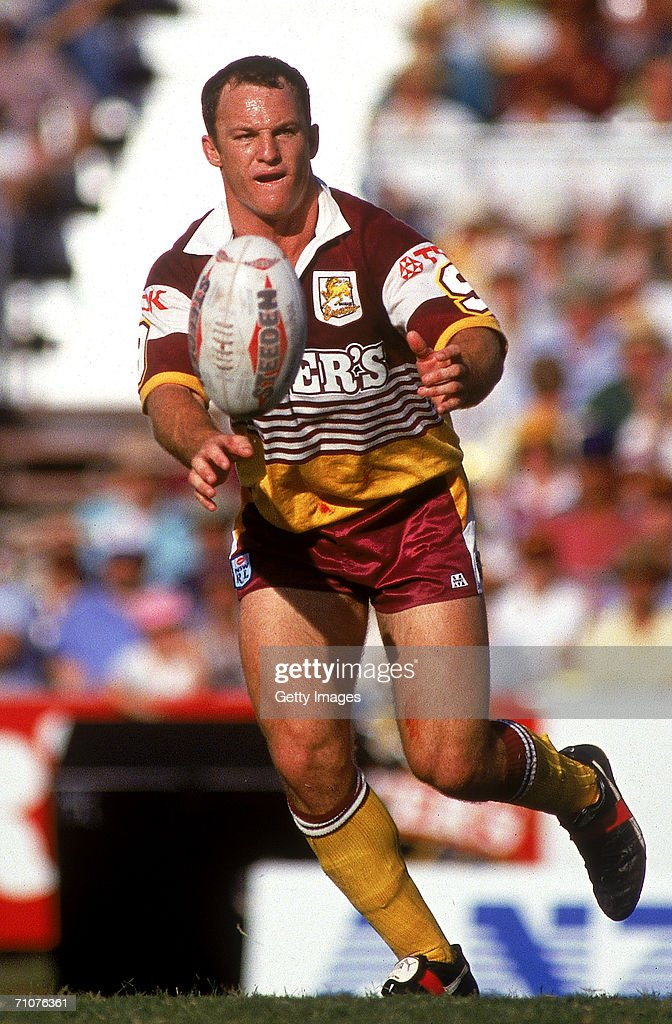 Kerrod Walters of the Broncos offloads the ball during a NSWRL match between the Brisbane Broncos and the Canberra Raiders at Lang Park 1993, in Brisbane, Australia.