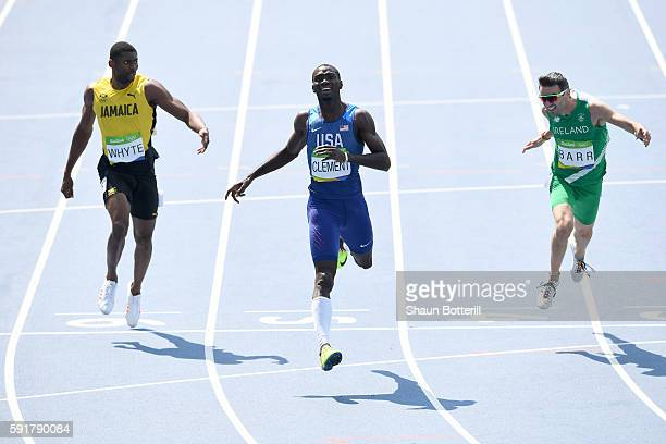 Kerron Clement of the United States leads Annsert Whyte of Jamaica and Thomas Barr of Ireland during the Men's 400m Hurdles Final on Day 13 of the...