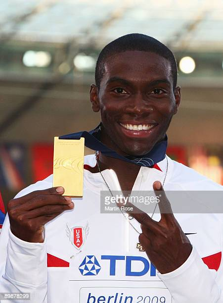Kerron Clement of United States receives the gold medal during the medal ceremony for the men's 400 Metres Hurdles Final during day five of the 12th...