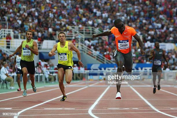 Kerron Clement of USA dips for the line and claim victory in the men's 400m hurdles from LJ van Zyl of South Africa and Periklis Iakovakis of Greece...