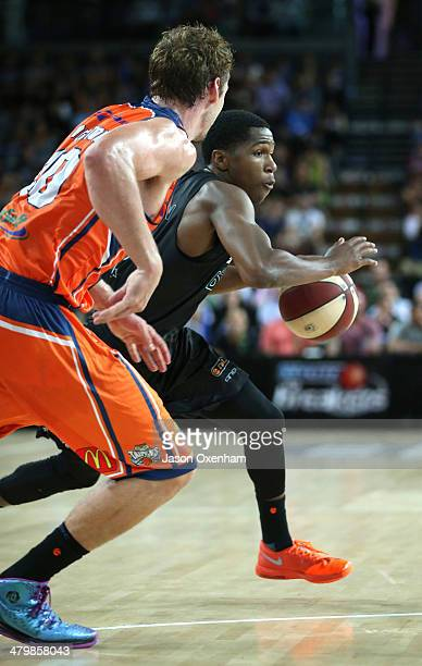 Kerron Johnson of the Breakers tries to speed around Clint Steindl of the Taipans during the round 23 NBL match between the New Zealand Breakers and...