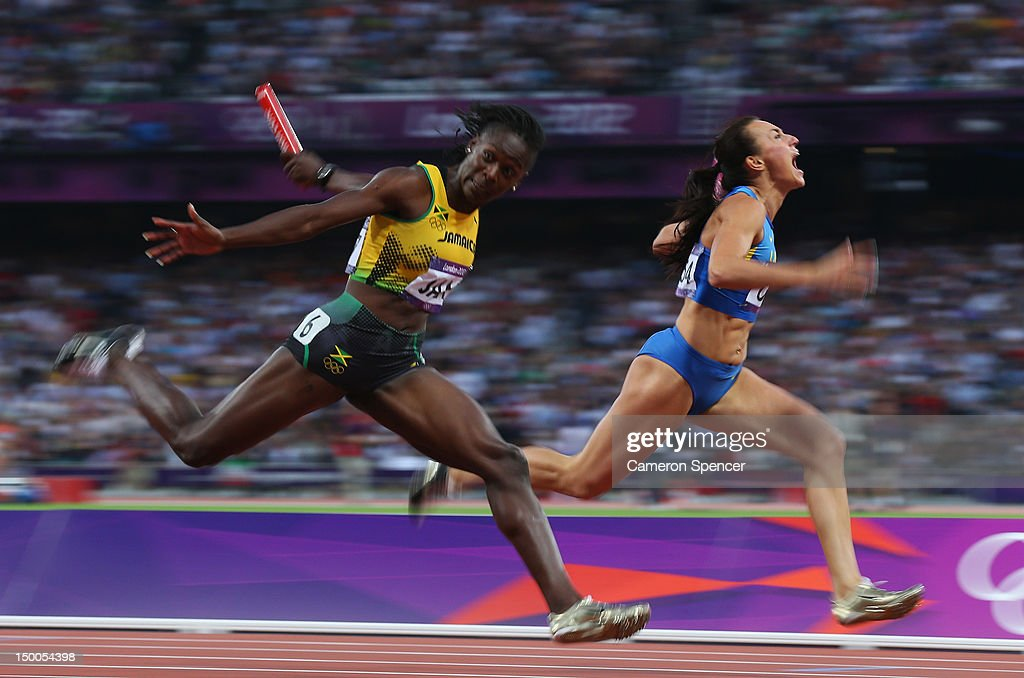 Kerron Stewart (L) of Jamaica and Elyzaveta Bryzgina of Ukraine race to the finish line during the Women's 4 x 100m Relay Round 1 on Day 13 of the London 2012 Olympic Games at Olympic Stadium on August 9, 2012 in London, England.