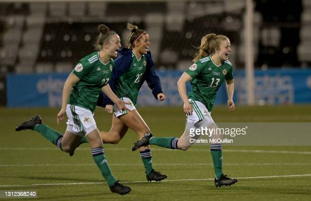 Kerry Anne Beattie, Ciara Waitling and Emma McMaster of Northern Ireland celebrate victory following the UEFA Women's Euro 2022 Play-off match...