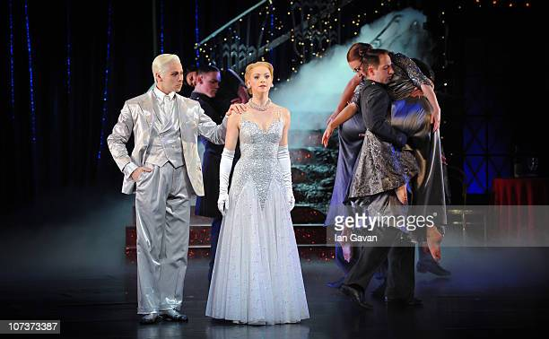 Kerry Biggin and Christopher Marney perform on stage during a photocall for Matthew Bourne's Cinderella at Saddler's Wells on December 7 2010 in...