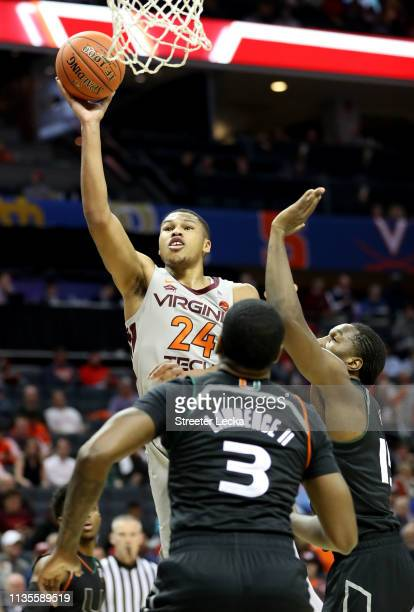 Kerry Blackshear Jr #24 of the Virginia Tech Hokies drives to the basket against teammates Ebuka Izundu and Anthony Lawrence II of the Miami...