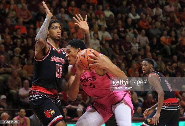 Kerry Blackshear Jr #24 of the Virginia Tech Hokies looks to shoot against Ray Spalding of the Louisville Cardinals at Cassell Coliseum on February...
