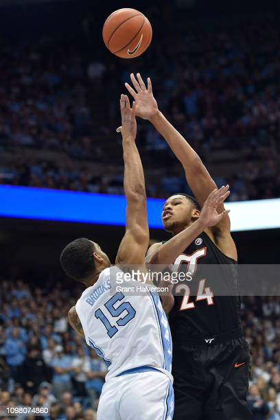 Kerry Blackshear Jr #24 of the Virginia Tech Hokies shoots over Garrison Brooks of the North Carolina Tar Heels during their game at the Dean Smith...