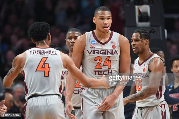 Kerry Blackshear of the Virginia Tech Hokies celebrates with Nickeil AlexanderWalker against the Liberty Flames in the second round of the 2019 NCAA...