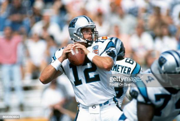 Kerry Collins of the Carolina Panthers drops back to pass against the Chicago Bears during an NFL football game October 8 1995 at Soldier Field in...