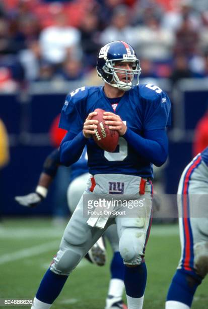 Kerry Collins of the New York Giants drops back to pass against the New Orleans Saints during an NFL game September 30 2001 at Giant Stadium in East...