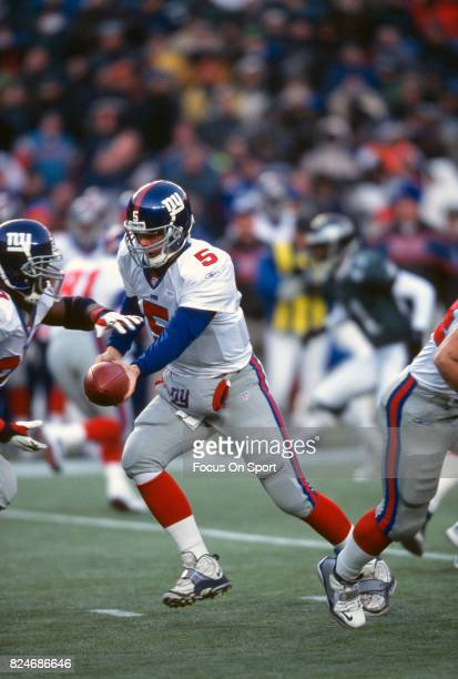 Kerry Collins of the New York Giants in action against the Philadelphia Eagles during an NFL game December 30 2001 at Veterans Stadium in...