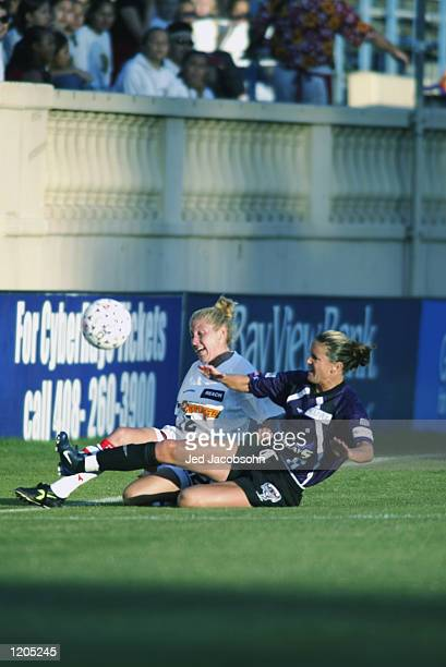 Kerry Collins of the Philadelphia Charge in action against Brandi Chastain of the San Jose CyberRays during a WUSA game on July 31, 2002 at Spartan...
