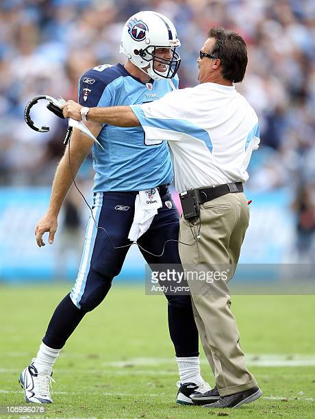 Kerry Collins of the Tennessee Titans celebrates with Titans Head Coach Jeff Fisher after Collins threw a touchdown pass in the fourth quarter during...