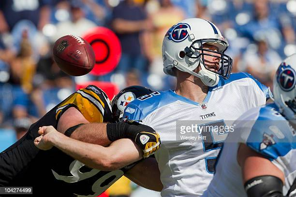 Kerry Collins of the Tennessee Titans is hit in the arm while throwing a pass by Brett Keisel of the Pittsburgh Steelers at LP Field on September 19...