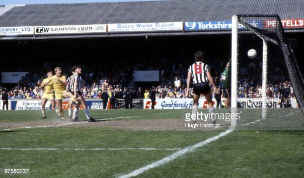Kerry Dixon of Chelsea scores the winning goal to win the league title during the Canon League Division Two match between Grimsby Town and Chelsea...
