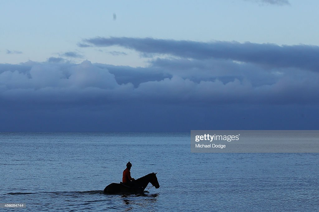 Kerry Edwards rides Superponi through the water during a trackwork session at Balnarring Beach on October 30, 2014 in Melbourne, Australia.
