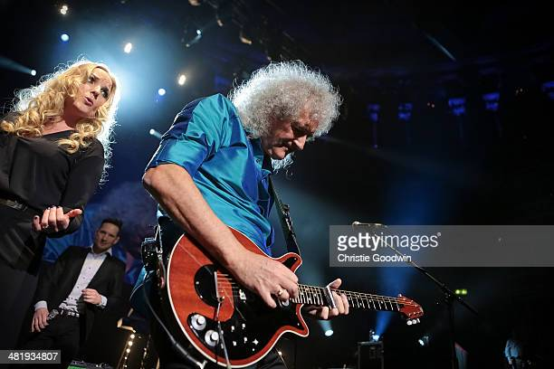 Kerry Ellis and Brian May perform on stage during City Rocks in aid of children's charity Coram at Royal Albert Hall on April 1 2014 in London United...