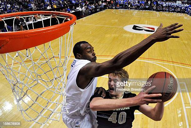 Kerry Hammonds II of the Middle Tennessee State University Blue Raiders blocks a shot by Josh Henderson of the Vanderbilt Commodores at Bridgestone...