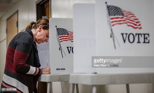 Kerry Hinton of Lakewood Colorado fills out her ballot at the Jefferson County Fairgrounds on November 8 2016 in Golden Colorado Voters go to the...