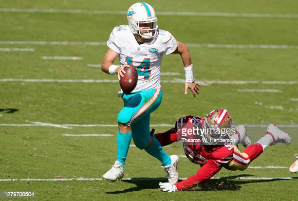 Kerry Hyder Jr. #92 of the San Francisco 49ers dives to sack quarterback Ryan Fitzpatrick of the Miami Dolphins during the first half of their game...