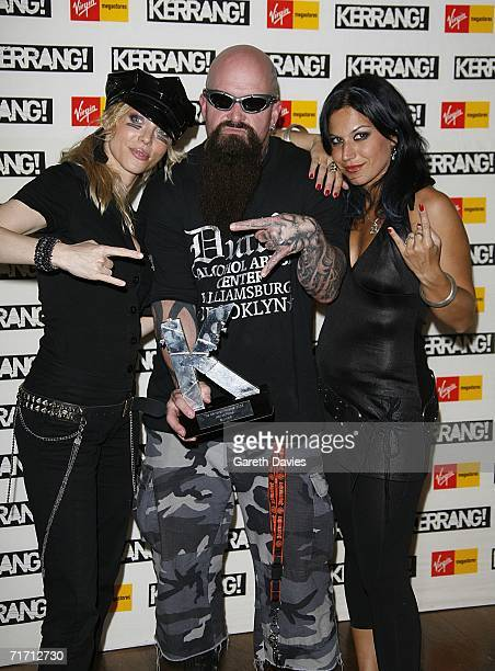Kerry King of Slayer poses with Angela Gossow and Christina Scabbia in the Awards Room with the award for Outstanding contribution to music at the...