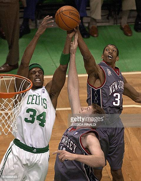 Kerry Kittles and Todd MacCulloch of the New Jersey Nets fight for a rebound with Paul Pierce of the Boston Celtics during game 3 of their NBA...