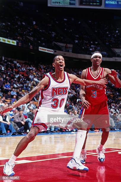 Kerry Kittles of the New Jersey Nets boxes out Allen Iverson of the Philadelphia 76ers at the Continental Airlines Arena in East Rutherford, New...