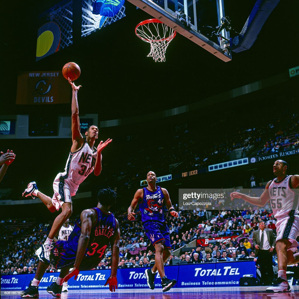 super popular 39f7b 9bf61 Kerry Kittles of the New Jersey Nets drives to the basket ...