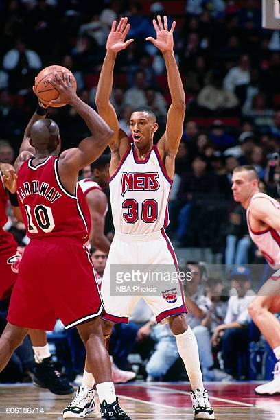 Kerry Kittles of the New Jersey Nets plays defense against Tim Hardaway of the Miami Heat at the Continental Airlines Arena on February 20 1997 in...