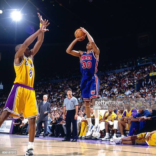 Kerry Kittles of the New Jersey Nets shoots the ball over Kobe Bryant of the Los Angeles Lakers at the Great Western Forum in Inglewood California on...