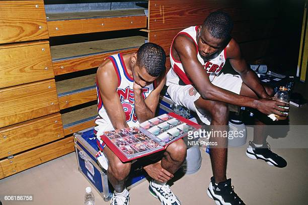 Kerry Kittles of the New Jersey Nets sits with Jermaine O'Neal of the Portland Trail Blazers during the 1996 NBA Rookie Photo Shoot on September 1,...