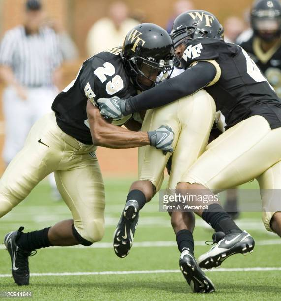 Kerry Major and Stanley Arnoux combine to make a tackle at the Wake Forest Spring Game on the campus of Wake Forest University in Winston-Salem in...