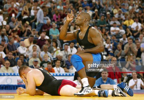 Kerry McCoy reacts to his victory over Tolly Thompson in the Freestyle 120KG Final Match 2 during the 2004 Olympic Team Trials of Wrestling at the...