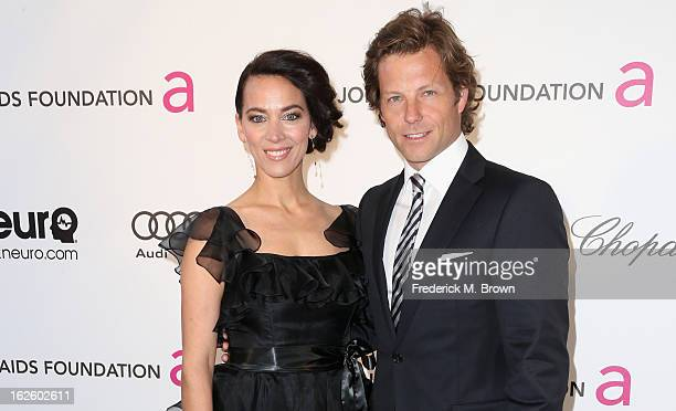 Kerry Norton and actor Jamie Bamber arrive at the 21st Annual Elton John AIDS Foundation's Oscar Viewing Party on February 24, 2013 in Los Angeles,...