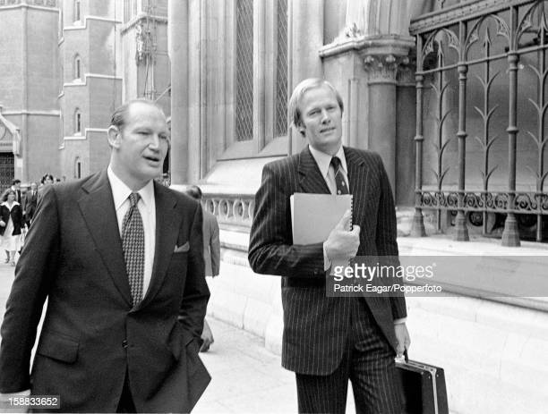Kerry Packer and Tony Greig outside the High Court in London at the end of the first day's hearing on September 26, 1977 in London, England.